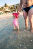 Happy father and adorable little girl at beach. Persian Gulf ,Dubai. Royalty Free Stock Images