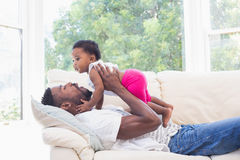 Happy father with baby girl on couch. At home in the living room Royalty Free Stock Image