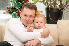 Happy father and baby girl cuddling at home. Stock Photo