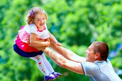 Happy father and baby girl having fun in park Stock Images