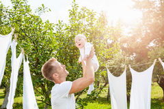 Happy father with a baby outdoors Stock Photography