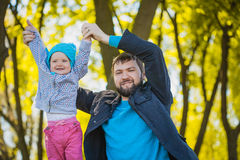 Happy father and baby playing in the park Royalty Free Stock Photos