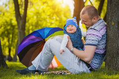 Happy father and baby are playing in the park Royalty Free Stock Image