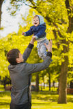 Happy father and baby are playing in the park Stock Image