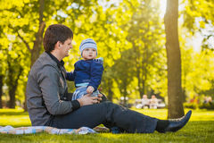 Happy father and baby are playing in the park Royalty Free Stock Images