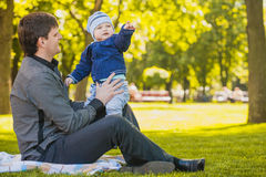 Happy father and baby are playing in the park Royalty Free Stock Photos