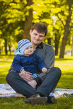 Happy father and baby are playing in the park Royalty Free Stock Photo