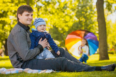 Happy father and baby are playing in the park Stock Photography