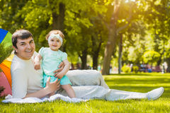 Happy father and baby are playing in the park Stock Photo
