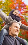 Happy father carrying son over autumn park royalty free stock images