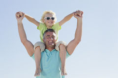 Happy father carrying son on shoulders Royalty Free Stock Images