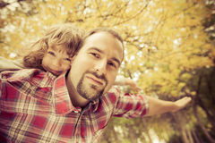 Happy father and child in autumn Royalty Free Stock Photos