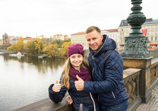 Happy father and child girl showing ok sign. Outdoors Royalty Free Stock Images