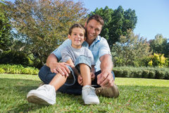 Happy father with child in a park Stock Images