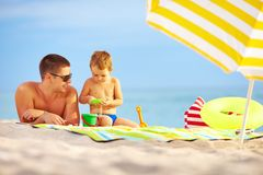 Happy father and child playing on the beach Stock Images