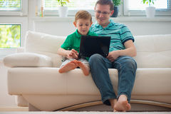 Happy father and child playing at home Royalty Free Stock Images