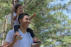 Happy father and child playing outdoor in nature stock photography