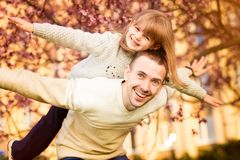 Happy father and child spending time outdoors. Family support royalty free stock photography