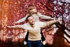 Happy father and child spending time outdoors. Family support stock photography