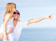 Happy father and child in sunglasses over blue sky Stock Images