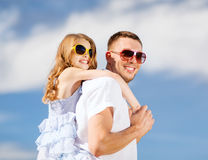 Happy father and child in sunglasses over blue sky Royalty Free Stock Photography