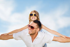 Happy father and child in sunglasses over blue sky Royalty Free Stock Photos