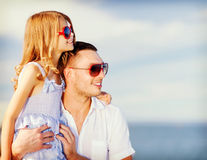 Happy father and child in sunglasses over blue sky Stock Photos