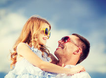 Happy father and child in sunglasses over blue sky Stock Image