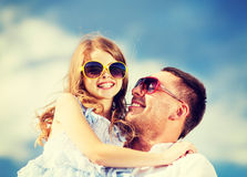 Happy father and child in sunglasses over blue sky Stock Photography