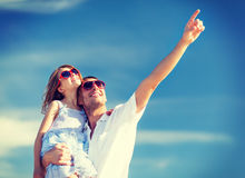 Happy father and child in sunglasses over blue sky Royalty Free Stock Images