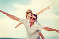 Happy father and child in sunglasses over blue sky Stock Photo