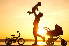 Happy father with child  on sunset Royalty Free Stock Images