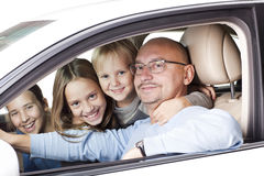 Happy father with children in the car Royalty Free Stock Photo