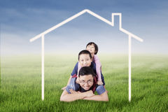 Happy father and children lying on lawn Royalty Free Stock Image
