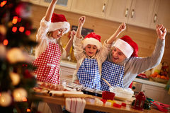 Happy father and children preparing Christmas cookies Royalty Free Stock Image