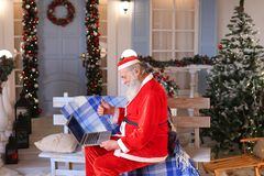 Funny Santa Claus showing thumbs up and working with laptop. Stock Photography