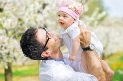 Happy father cuddling his cute daughter Stock Image