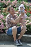 Happy father and cute baby daughter in the park stock photo