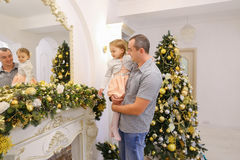 Happy father and cute daughter with regard festive decorations o Royalty Free Stock Image