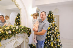 Happy father and cute daughter with regard festive decorations o Royalty Free Stock Images