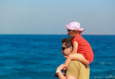 Happy father and cute kid sitting Royalty Free Stock Photos