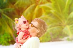 Happy father and cute little daughter at beach Royalty Free Stock Image