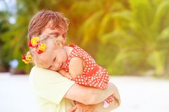 Happy father and cute little daughter at beach Stock Image