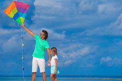 Happy father and cute little daughter flying kite Stock Photo