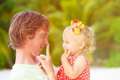 Happy father and cute little daughter play at Royalty Free Stock Photos