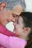Father and daughter hugging stock images