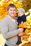 Happy father with daughter in autumn park Stock Photos