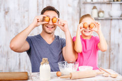 Happy father and daughter baking together Royalty Free Stock Images