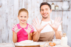 Happy father and daughter baking together Stock Photography