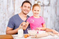 Happy father and daughter baking together Stock Image